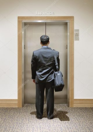businessman-waiting-for-an-elevator